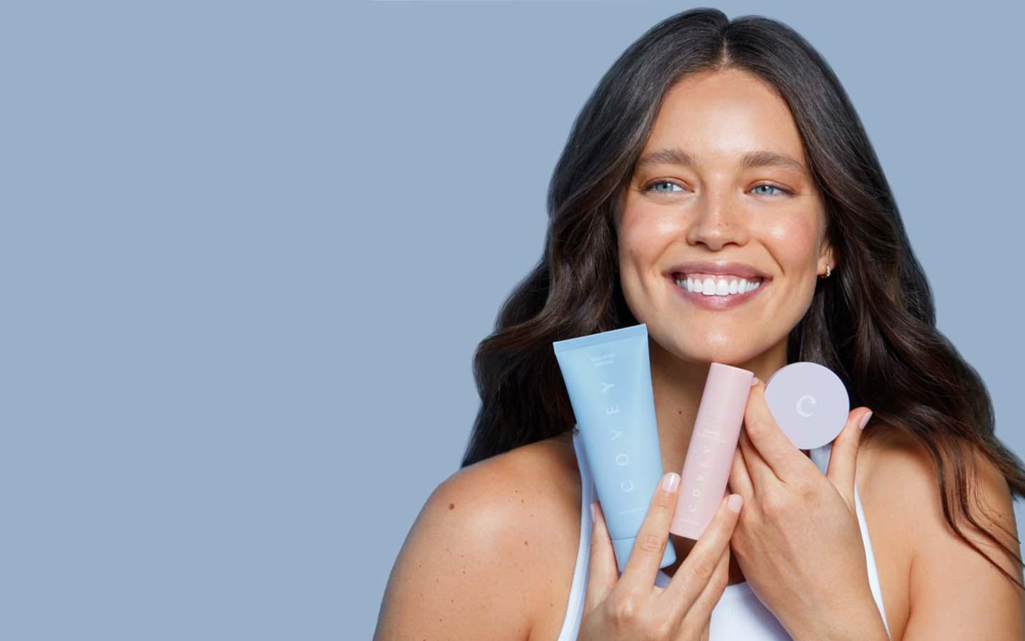 Emily DiDonato holding skincare products